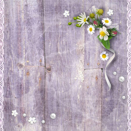 rustic: Old wooden planks with a bouquet of flowers and lace Stock Photo