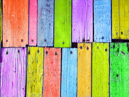Colorful wood board nailed, grunge background  photo