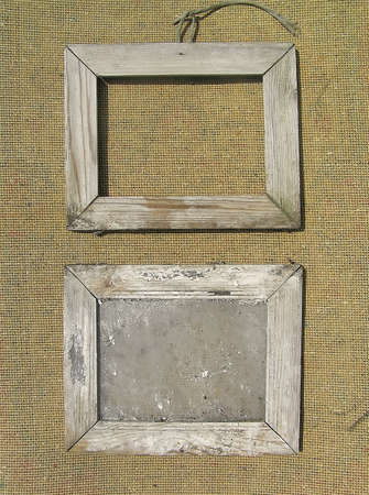 books on a wooden surface: Two old wooden picture frame on the surface texture of burlap. Template for the design of photo books