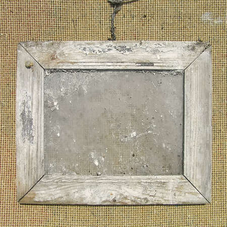 Old wooden picture frame on the wall texture. Template for the design of photo albums.