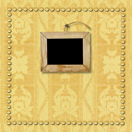 Old wooden picture frame hanging on the wall. The page template for a photo book album photo