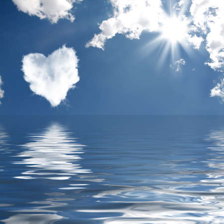 reflected: Cloud-shaped heart on a sky reflected in the water. Valentines Day Stock Photo