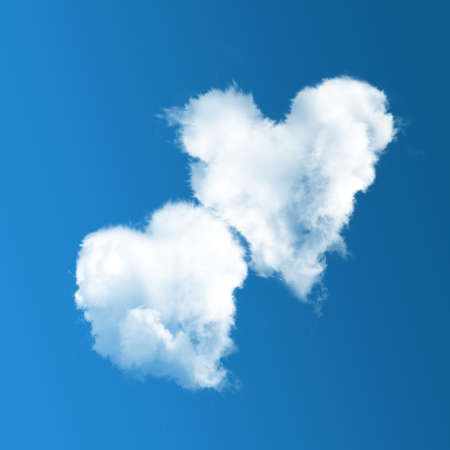 Two heart-shaped clouds on blue sky background.  Valentine's Day