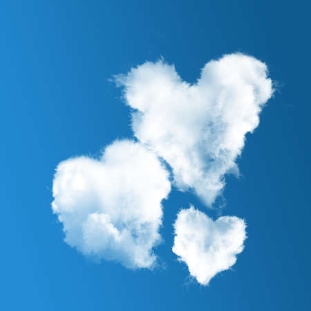 three heart-shaped clouds on blue sky background.  Concept of family photo