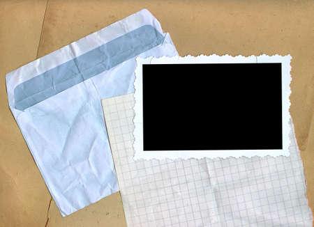 Crumpled envelope, squared paper, photo edges. Stock Photo - 15315758