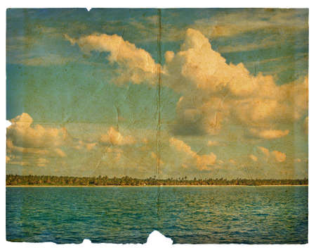 Landscape on old paper - the sea, the sky, the beach with palm trees. Dominican Republic photo