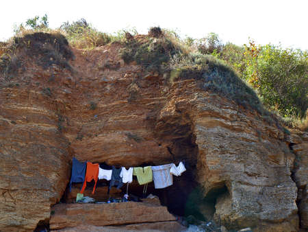 Cave of the shell, clothes drying on a rope      photo