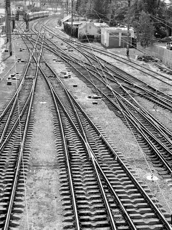 black and white railroad tracks: The panorama of railroad tracks. Top view. black and white image, monochrome.