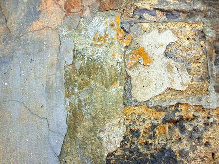 coquina: La textura de la antigua muralla de la coquina agrietado y pintura suelta. Fondo de la vendimia