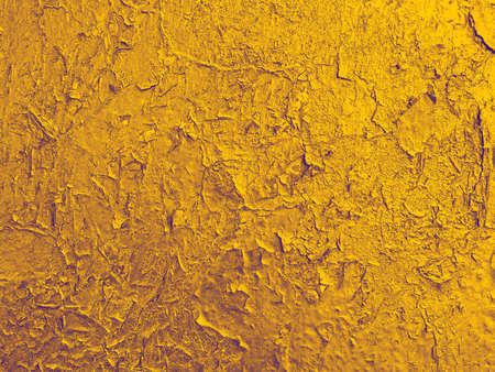 texture of old wall with a  cracked golden paint. Vintage craquelure background photo