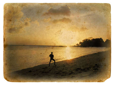 Silhouette of a man on the beach, sunset. Old postcard, design in grunge and retro style Stock Photo - 16729296