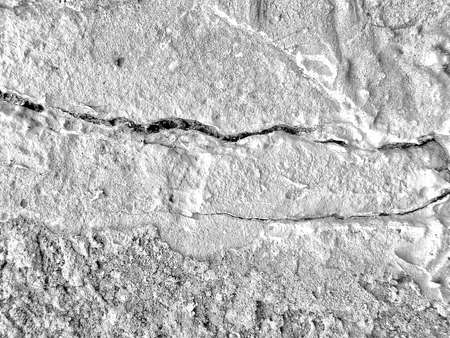 black and white texture of old wall with cracks. Vintage background