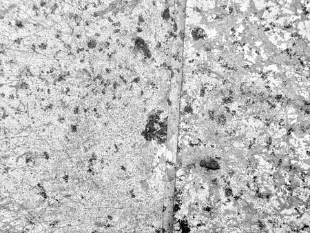 monochrome texture of old wall with cracks. Vintage background
