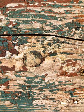Cracked painted wooden board. Vintage background for design