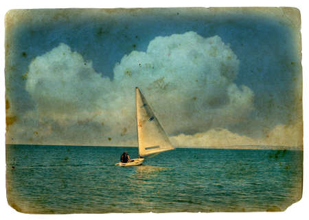sailboat at sea. Old postcard, design in grunge and retro style. Isolated on white background. Made by me using Photoshop from my photo.