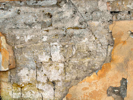 decrepit: Texture of the old walls of coquina with shattered plaster yellow Stock Photo
