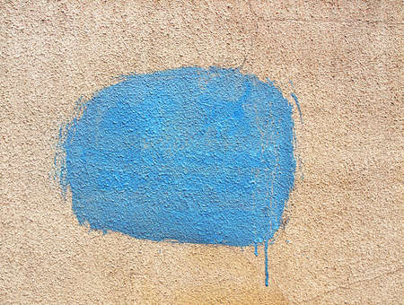 Blue spot of paint on stucco wall Banque d'images