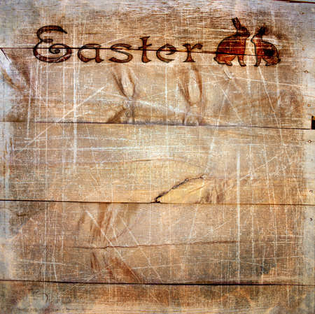 Wooden planks with stamping Easter, scratches and texture. Textured background images for photo book design