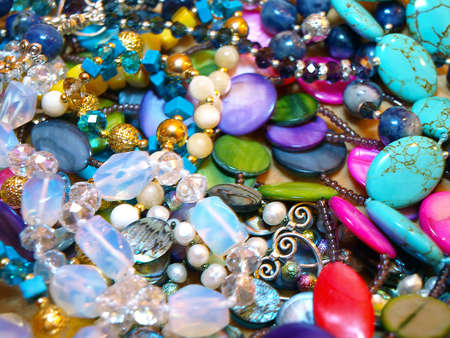 lapis: Scattering beads of semiprecious stones - lapis lazuli, turquoise, moonstone, pearl, rhinestone Stock Photo