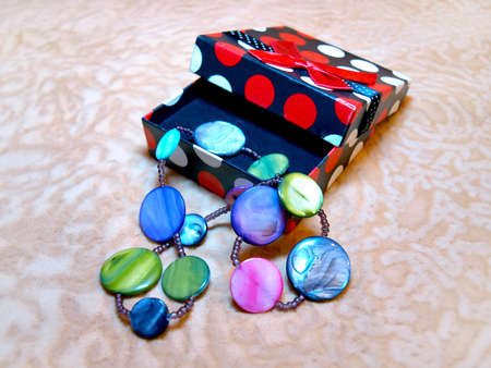 Bright, beautiful female accessory made of natural pearl in a gift box