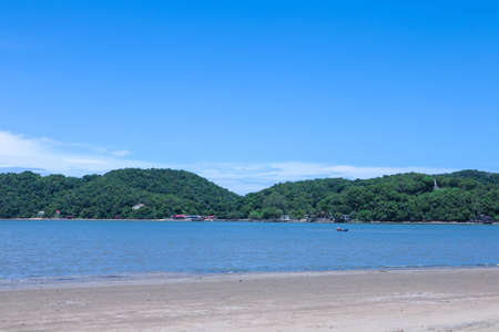 Mountain sea sand beach landscape. Sea sand beach in mountains. Mountain sea beach landscape. Mountain beach view Foto de archivo