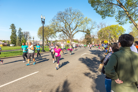 credit union: Washington DC, USA - Apr.12,2015 : Joggers and runners participated in the event of Credit Union Cherry Blossom 5K run-walk