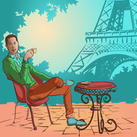 Young stylish man sitting in the street caffee in Paris and enjoying his morning coffee