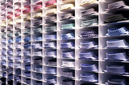 clothes rack: Folded colourful shirts on clothes rack
