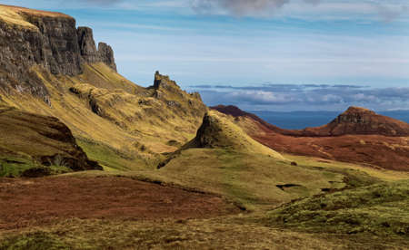 Scenic view of Quiraing mountains with blue sky, Isle of Skye photo
