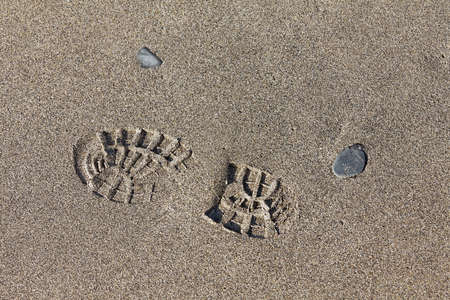 hiking boot: Imprint of the hiking boot on sand