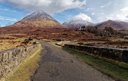 the old road: Old road leading to high, snowy mountains