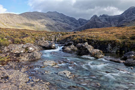 Fairy Pools in bright, autumn day - with montains in background