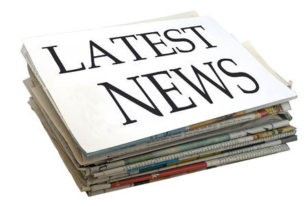 latest news: Paper stack. Top file showing latest news.