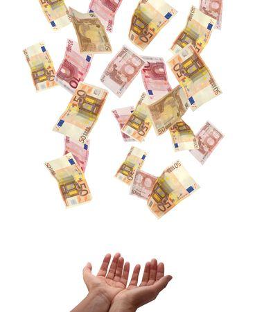 european union currency: Uni�n Europea de divisas por encima de la ca�da en manos de alguien. Aislado en fondo blanco.