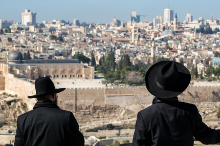 hasid: Hasids looks at the Temple Mount from Mount Olive Stock Photo