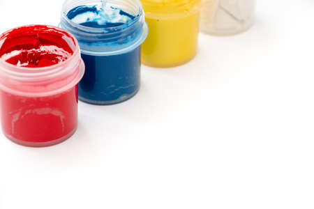 Watercolor paint in buckets isolated on white background. Art palette. Colorful paint. Gouache in the jar. Stock Photo