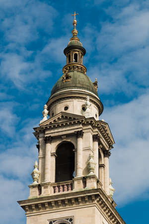 Fragment of St. Stephens Basilica in Budapest, Hungary. Roman catholic church in neoclassical style against the blue sky