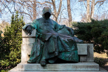 Budapest, Hungary - March 11, 2017: Statue of Anonymous located in city park in the courtyard of Vajdahunyad Castle. This is the first medieval Hungarian chronicler Editorial