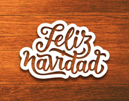 Feliz Navidad spanish Merry Christmas text on white paper cut style label over wood background. Lettering for season greetings. Vector background