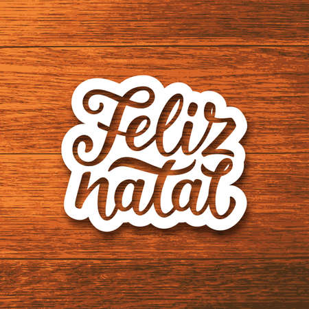 Feliz Natal portuguese Merry Christmas text on white paper cut style label over wood background. Lettering for season greetings. Vector background