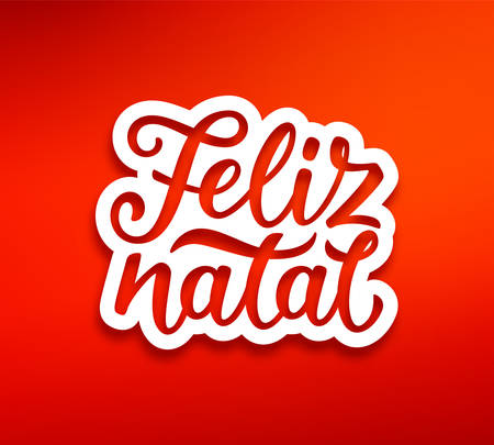Feliz Natal portuguese Merry Christmas text on white paper label with carving.