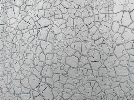 Old cracked paint texture on the wall. Close-up of vintage damaged surface Stock Photo