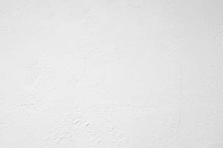 White textured wall. Decorative plastering close-up photo. Surface with stucco daub Zdjęcie Seryjne
