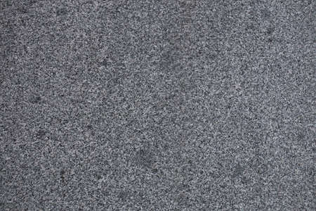 Gray granite texture. Subtle grain stone background. Dark rough granitic wall closeup Stock Photo