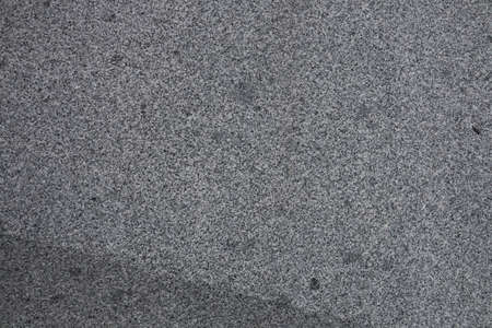 Gray granite texture. Subtle grain stone background. Dark rough granitic wall