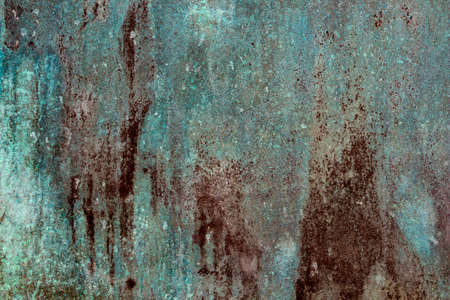 Ancient wall texture with patina or copper oxide stains. Grunge rusty background. Antique surface structure