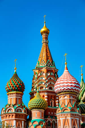 Architecture of St Basil Cathedral on the Red Square in Moscow, Russia. Orthodox church against blue sky in sunny day. Main tourist destination
