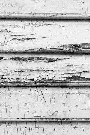 Wood texture close-up photo. Vintage wooden wall background. White cracked paint plank panels