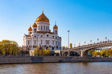 Cathedral of Christ the Savior and Patriarchal bridge over the river in Moscow, Russia. Russian orthodox church in sunny spring day and blue sky in the background Reklamní fotografie