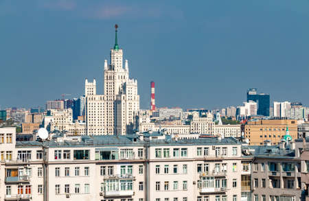Cityscape of Moscow with houses and high-rise tower in soviet architecture style, Russia capital city center